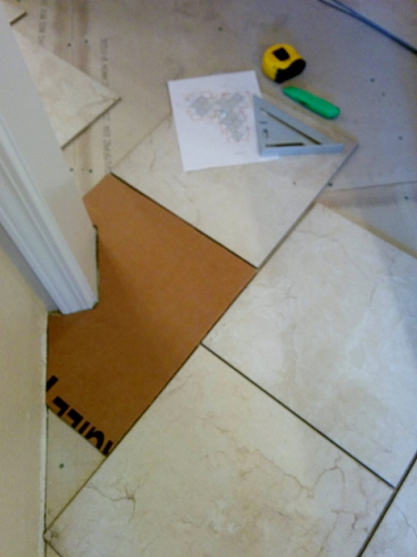 A cardboard template for floor tile