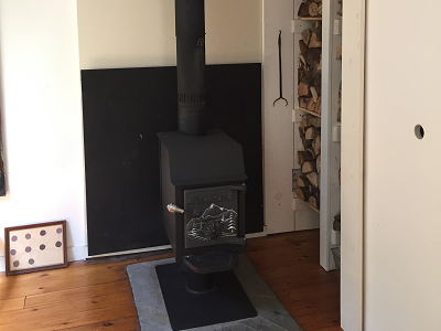 Wood burning stove with stacked logs