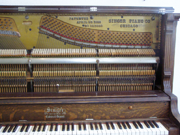 Inside upright piano