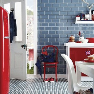 red kitchen chairs with subway tile