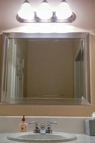 Hanging a Mirror Over Your Vanity | ImprovementCenter.com