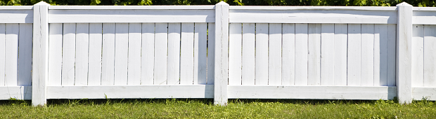 White fence around a yard