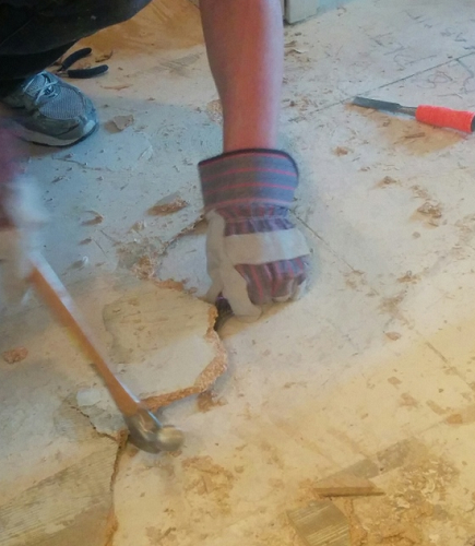 demoing a bathroom floor